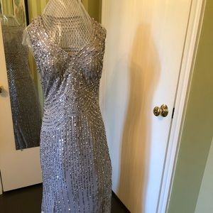 Glamorous gray and silver sequin evening gown.